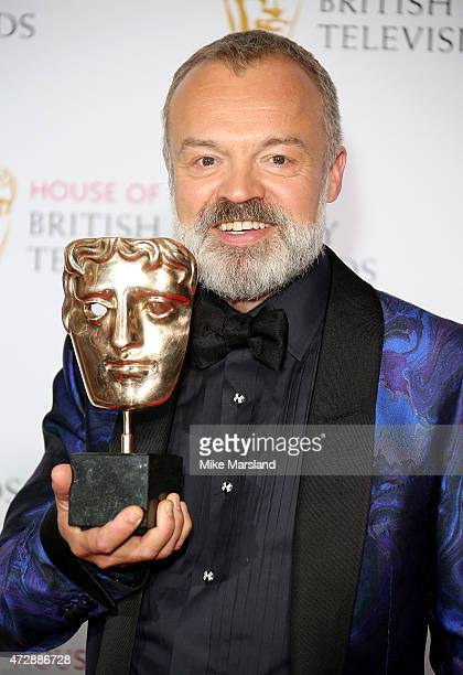 Graham Norton poses in the winners room at the House of Fraser British Academy Television Awards at Theatre Royal on May 10 2015 in London England