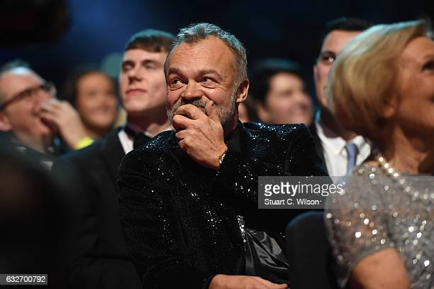 Graham Norton reacts to winning the Special Recognition Award during the National Television Awards at The O2 Arena on January 25 2017 in London...