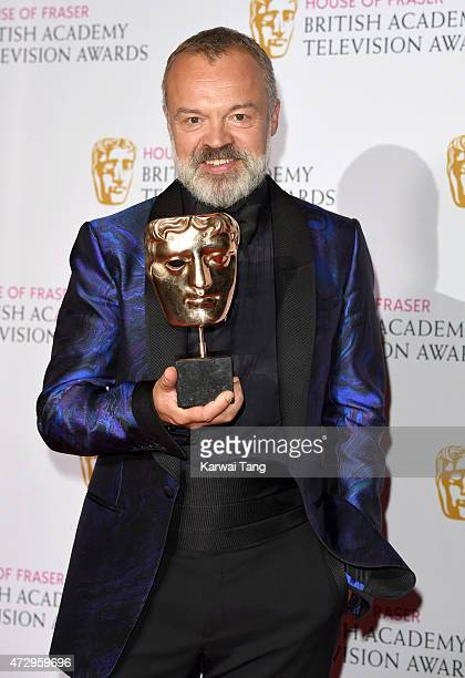 Graham Norton winner of Comedy and Comedy Entertainment Programme poses in the winners room at the House of Fraser British Academy Television Awards...