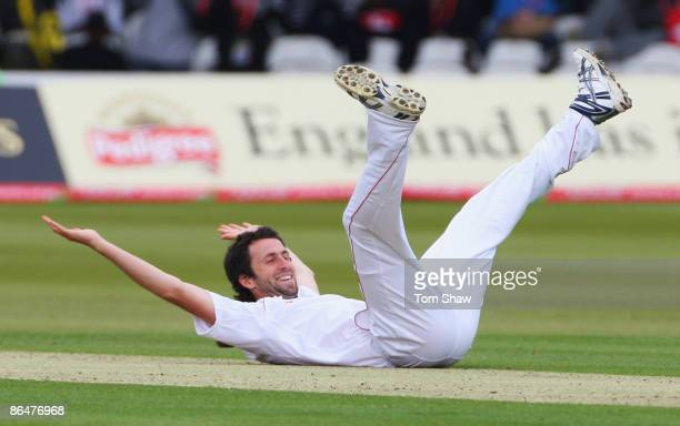 Graham Onions of England celebrates the wicket of Denesh Ramdin of West Indies during day two of the 1st npower Test match between England and West...