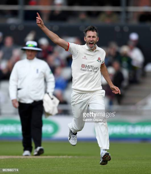 Graham Onions of Lancashire celebrates dismissing Mark Stoneman of Surrey during the Specsavers County Championship Division One match between...