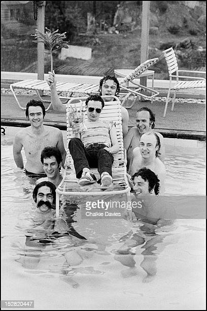 Graham Parker And The Rumour in a swimming pool at a hotel in Los Angeles, 1977. Graham Parker is centre with John 'Irish' Earle, Andrew Bodnar,...