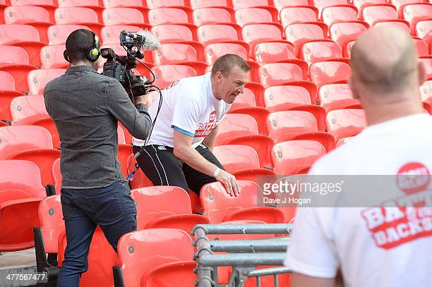 Graham Poll attends 'The Battle of the Backsides' photocall at Wembley Stadium on March 10 2014 in London England Alan Shearer and Robbie Savage are...