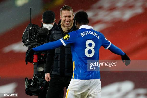 Graham Potter, Head Coach of Brighton and Hove Albion celebrates victory with Yves Bissouma of Brighton and Hove Albion following the Premier League...
