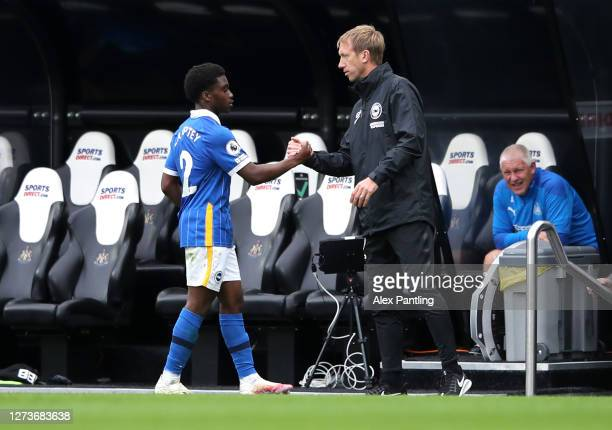 Graham Potter, Head Coach of Brighton and Hove Albion greets Tariq Lamptey of Brighton and Hove Albion as he is substituted off during the Premier...