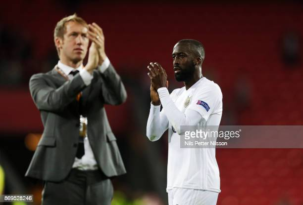 Graham Potter head coach of Ostersunds FK and Ronald Mukibi of Ostersunds FK cheers to the fans after the UEFA Europa League group J match between...