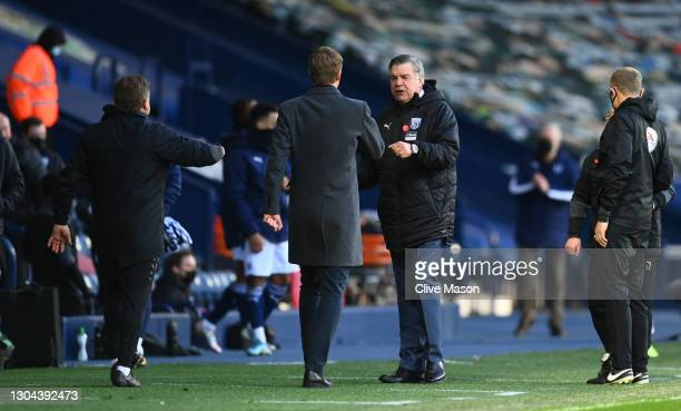 Graham Potter, Manager of Brighton and Hove Albion speaks with Sam Allardyce, Manager of West Bromwich Albion following the Premier League match...