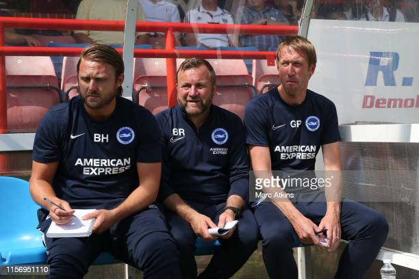 ALDERSHOT ENGLAND JULY Graham Potter manager of Brighton and Hove Albion with Assistant head coach Billy Reid and First team coach Bjorn Hamberg...