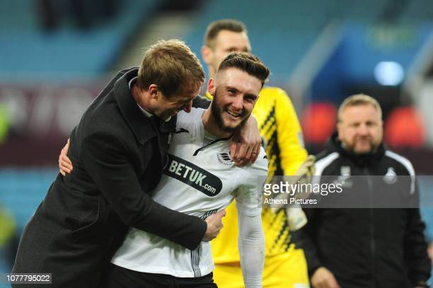 Graham Potter Manager of Swansea City reacts with Matt Grimes of Swansea City during the FA Cup Third Round match between Aston Villa and Swansea...