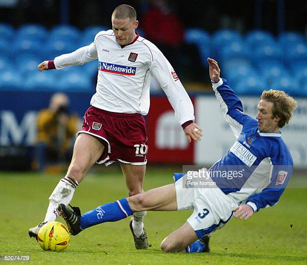 Graham Potter of Macclesfield Town tackles Josh Low of Northampton Town during the Coca Cola League Two match Macclesfield Town v Northampton Town...