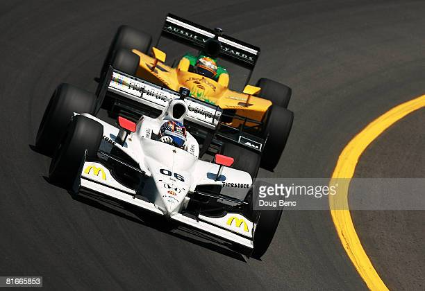 Graham Rahal driver of the Hole in the Wall Camps Newman/Haas and Lanigan Racing Dallara Honda drives into turn three ahead of Will Power driver of...