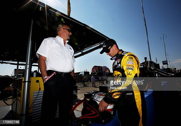 Graham Rahal driver of the Midas/Big O Tyres Honda prepares for practice as his father and team owner Bobby Rahal watches on during the Milwaukee...