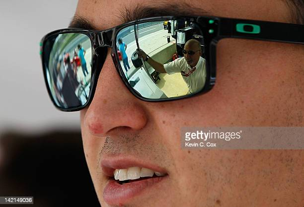 Graham Rahal driver of the Service Central Chip Ganassi Racing Honda converses with his father Bobby Rahal during practice for the IndyCar Series...