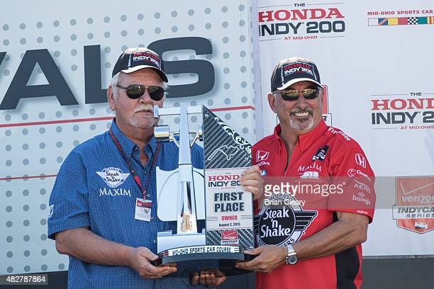 Graham Rahal's car owners Bobby Rahal right and Mike Lanigam celebrate after winning the Honda Indy 200 at MidOhio Sports Car Course on August 2 2015...