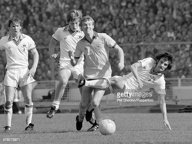 Graham Rix of Arsenal is tackled by Alan Devonshire of West Ham United watched by Geoff Pike and Paul Allen during the FA Cup Final at Wembley...