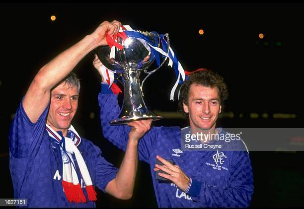 Graham Roberts and Trevor Francis both of Rangers hold the trophy aloft after their victory in the Skol Cup Final against Aberdeen at Hampden Park in...