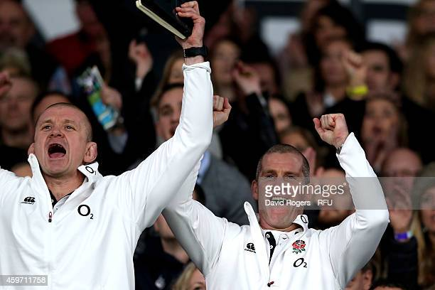 Graham Rowntree, the England forwards coach, celebrates with Stuart Lancaster the head coach of England after winning the QBE international match...