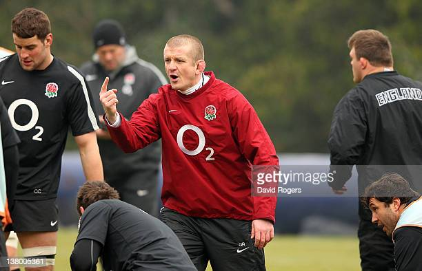 Graham Rowntree, the England forwards coach issues instructions during the England training session held at Pennyhill Park on January 31, 2012 in...