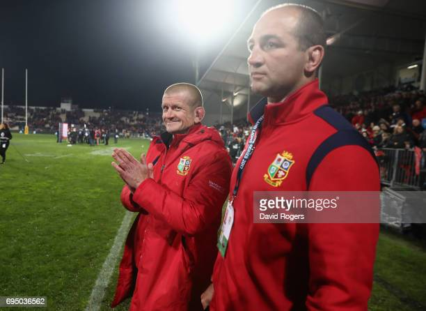 Graham Rowntree, the Lions scrum coach smiles with forwards coach Steve Borthwick after their victory during the match between the Crusaders and the...
