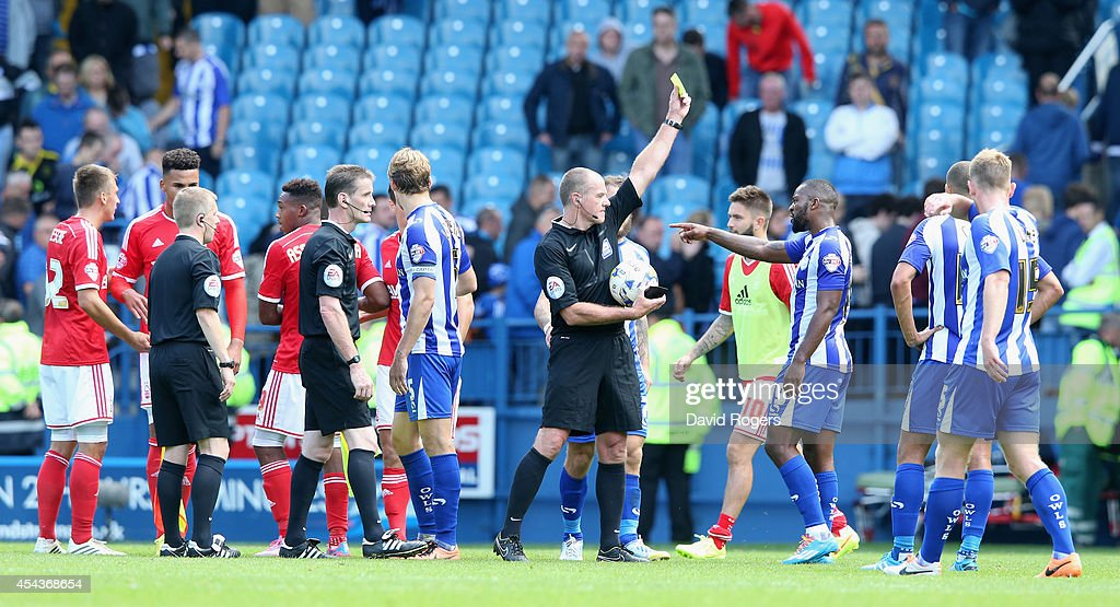 Graham Salisbury, the referee shows the yellow card to Sheffield Wednesday's Jacques Maghoma after the final whistle during the Sky Bet Championship match between Sheffield Wednesday and Nottingham Forest at Hillsborough Stadium on August 30, 2014 in Sheffield, England.