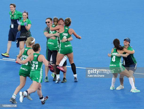 Graham Shaw of Ireland celebrates his team's victory with players and staff following the Quarter Final game between Ireland and India of the FIH...