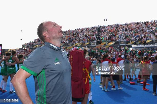 Graham Shaw of Ireland looks to the sky as he celebrates their victory during the SemiFinal game between Ireland and Spain of the FIH Womens Hockey...