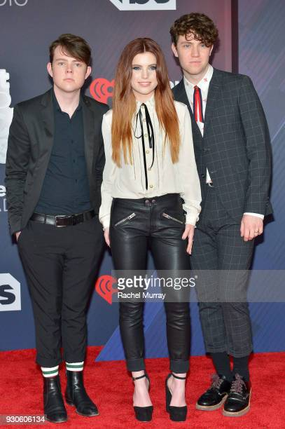 Graham Sierota Sydney Sierota and Noah Sierota of Echosmith arrive at the 2018 iHeartRadio Music Awards which broadcasted live on TBS TNT and truTV...