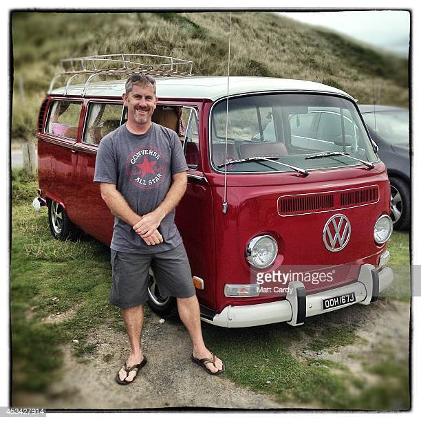 Graham Snodden from Chesterfield poses for a photograph besides his 1971 early second generation or T2 bay window Volkswagen Transporter van near...