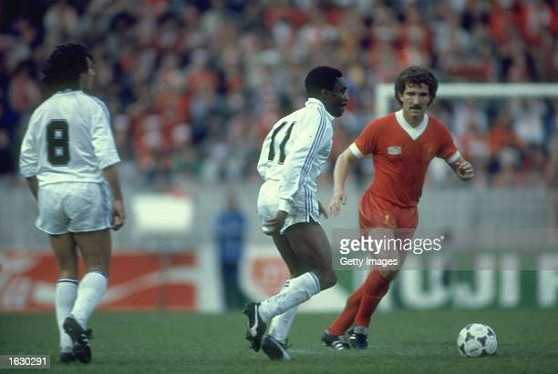 Graham Souness of Liverpool takes on Laurie Cunningham of Real Madrid during the European Cup final at Parc des Princes in Paris Liverpool won the...
