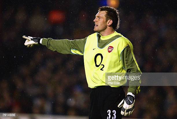 Graham Stack of Arsenal organises his defence during the Carling Cup SemiFinal first leg match between Arsenal and Middlesbrough held on January 20...