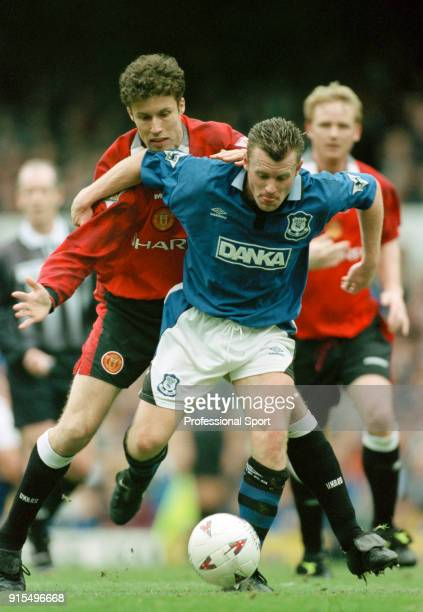 Graham Stuart of Everton holds off Ronny Johnsen of Manchester United during an FA Carling Premiership match at Goodison Park on March 22 1997 in...