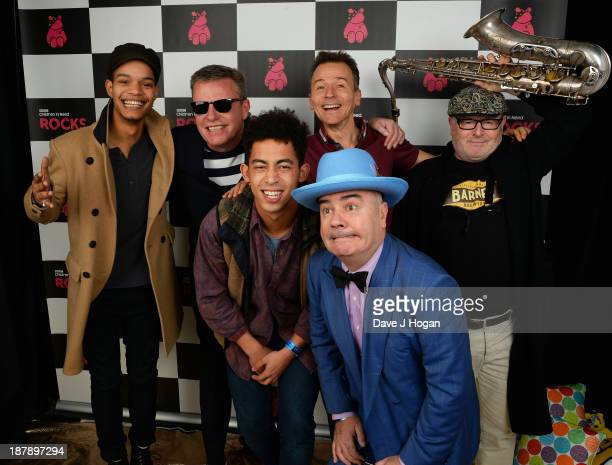 Graham Suggs McPherson Daniel Woody Woodgate Chris Chrissy Boy Foreman and Lee Kix Thompson of Madness pose with Harley AlexanderSule and Jordan...