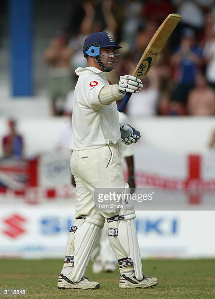 Graham Thorpe of England celebrates reaching his half century during day 3 of the 2nd Test Match between the West Indies and England at Queens Park...