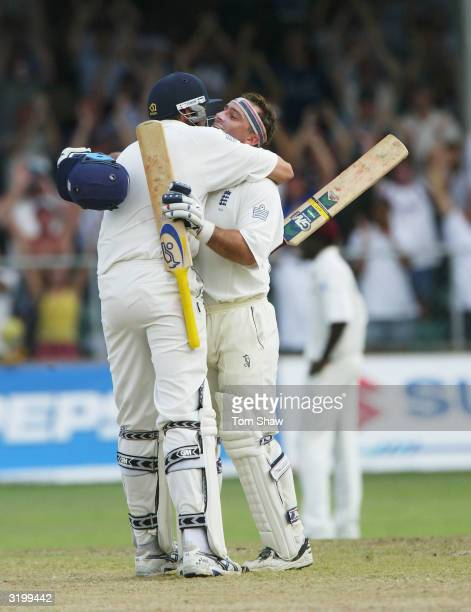 Graham Thorpe of England is given a hug by Steve Harmison after reaching his century during day two of the 3rd Test match between the West Indies and...