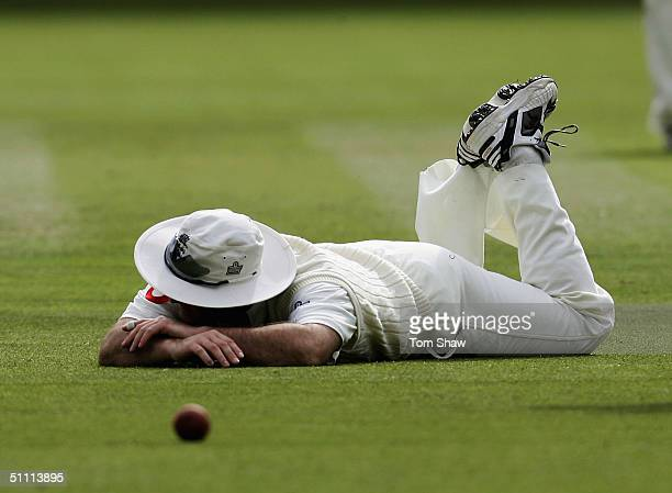 Graham Thorpe of England lies on the ground after dropping a catch during day four of the England v West Indies 1st Npower Test match at Lords...