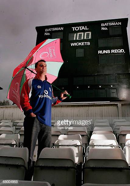 Graham Thorpe of England poses in front of the scoreboard with 100 up to mark his 100th test appearance during the England nets session prior to the...