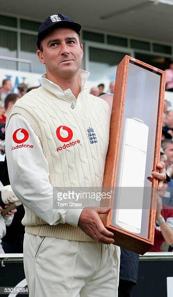 Graham Thorpe of England receives a commemorative bat to mark his 100th test match during the 2nd Npower Test match between England and Bangladesh at...