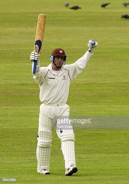 Graham Thorpe of Surrey celebrates his century on the first day of the Frizzell County Championship, Division One match between Surrey and Sussex on...