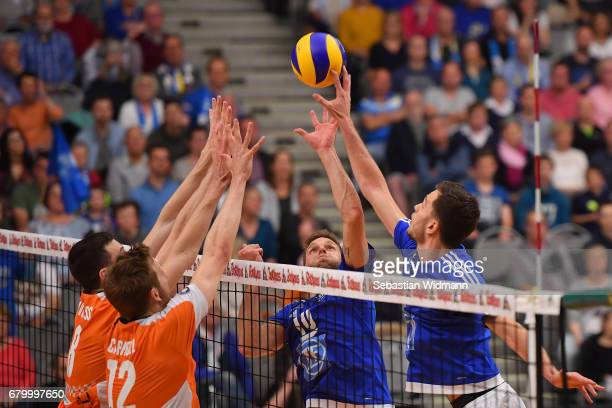 Graham Vigrass Paul Carroll of Berlin Recycling Volleys and Simon Tischer and David Sossenheimer of VFB Friedrichshafen compete for the ball during...