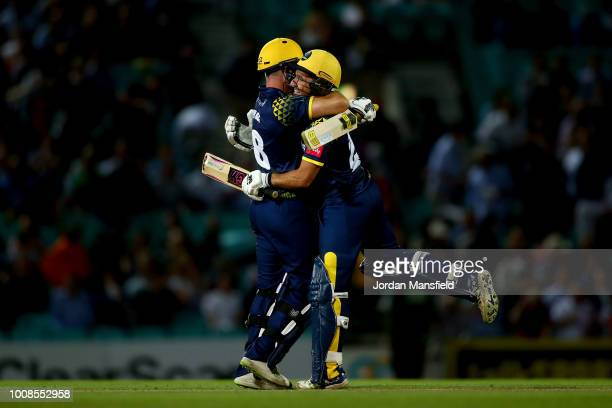 Graham Wagg and Andrew Salter of Glamorgan celebrate victory during the Vitality Blast match between Surrey and Glamorgan at The Kia Oval on July 31...