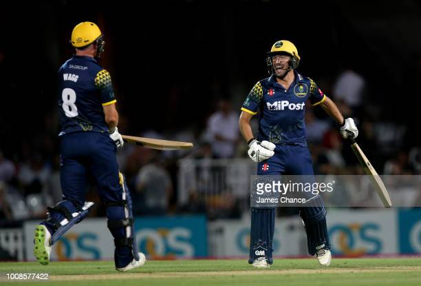 Graham Wagg of Glamorgan celebrates victory with Andrew Salter of Glamorgan after the Vitality Blast match between Surrey and Glamorgan at The Kia...