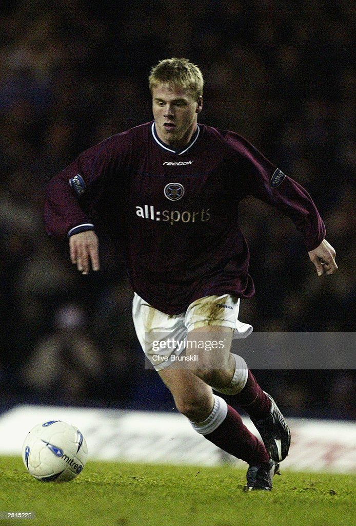 Graham Weir of Heart of Midlothian running with the ball during the Bank of Scotland Scottish Premier League match between Rangers and Hearts on December 20, 2003 at Ibrox in Glasgow, Scotland. Rangers won the match 2-1.