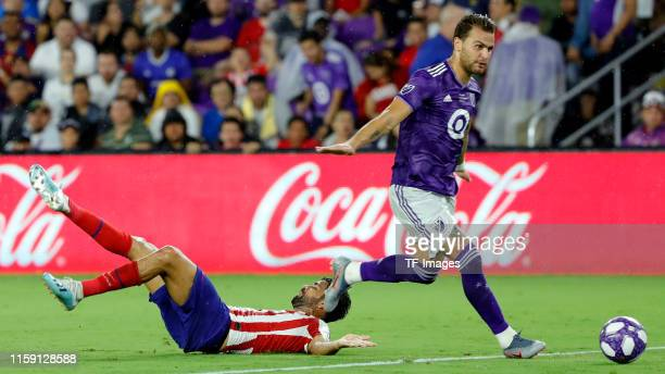 Graham Zusi of MLS All-Stars and Joao Felix of Atletico de Madrid battle for the ball during the 2019 MLS All-Star Game between MLS All Stars and...