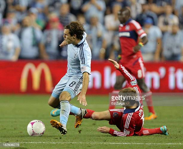 Graham Zusi of Sporting Kansas City battles for the ball against Chris Rolfe of the Chicago Fire in the second half at Livestrong Sporting Park on...