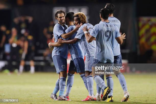 Graham Zusi of Sporting Kansas City celebrates with his teammates after scoring a goal in the 91st minute against the Colorado Rapids during a Group...