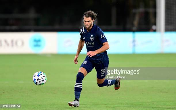 Graham Zusi of Sporting Kansas City controls the ball during a quarterfinals match against Philadelphia Union during the MLS Is Back Tournament at...