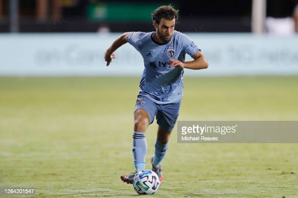 Graham Zusi of Sporting Kansas City in action against the Colorado Rapids during a Group D match as part of the MLS Is Back Tournament at ESPN Wide...