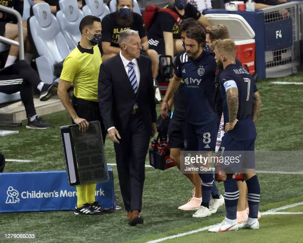 Graham Zusi of Sporting Kansas City is led off the field after an injury during the game against the Chicago Fire at Children's Mercy Park on October...