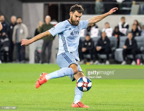 Graham Zusi of Sporting Kansas City takes a shot during Los Angeles FC's MLS match against Sporting Kansas City at the Banc of California Stadium on...