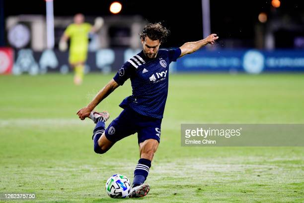 Graham Zusi of Sporting Kansas City takes a shot on goal during a round of sixteen match between Sporting Kansas City and Vancouver Whitecaps as part...